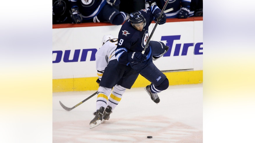 Buffalo Sabres' Steve Ott (9) hip-checks Winnipeg Jets' Evander Kane (9) during the third period of their NHL hockey game in Winnipeg, Manitoba, Tuesday, April 9, 2013. The Jets won 4-1. (AP Photo/The Canadian Press, Trevor Hagan)