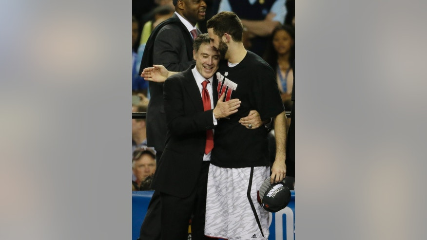 Louisville head coach Rick Pitino embraces Louisville guard/forward Luke Hancock after the second half of the NCAA Final Four tournament college basketball championship game against Michigan, Monday, April 8, 2013, in Atlanta. (AP Photo/Chris O'Meara)