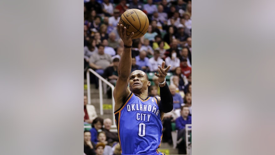Oklahoma City Thunder's Russell Westbrook (0) lays the ball up in the first quarter during an NBA basketball game against the Utah Jazz, Tuesday, April 9, 2013, in Salt Lake City. (AP Photo/Rick Bowmer)
