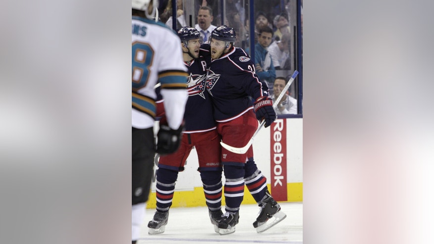 Columbus Blue Jackets' James Wisniewski, right, celebrates his goal against the San Jose Sharks with teammate Adrian Aucoin during the second period of an NHL hockey game Tuesday, April 9, 2013, in Columbus, Ohio. (AP Photo/Jay LaPrete)