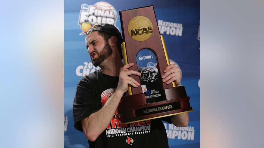 Louisville guard/forward Luke Hancock speaks  during a news conference after the NCAA Final Four tournament college basketball championship game against Michigan, Tuesday, April 9, 2013, in Atlanta. Louisville won 82-76.  (AP Photo/Charlie Neibergall)