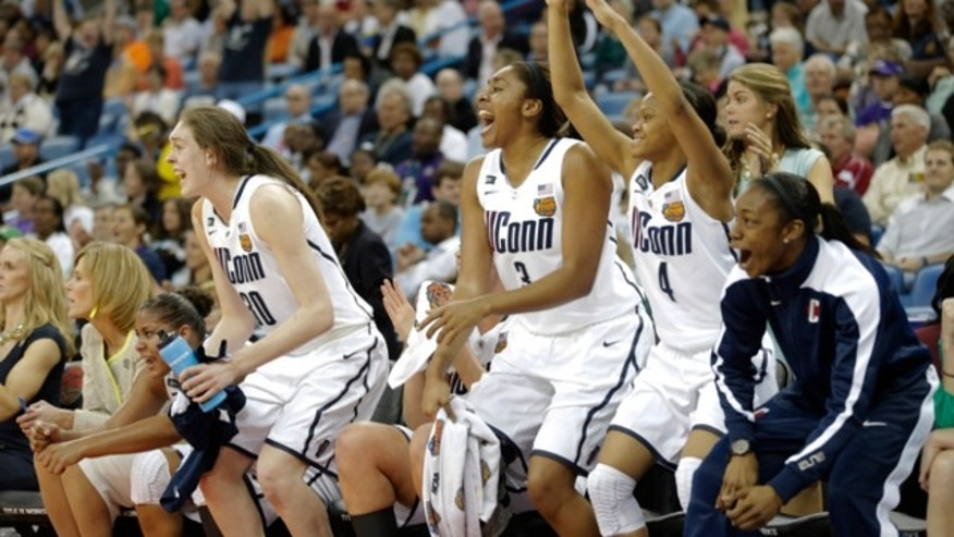 April 9, 2013: Connecticut players react against Louisville in the second half of the national championship game of the women's Final Four of the NCAA college basketball tournament in New Orleans.