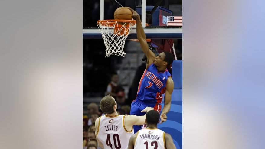 Detroit Pistons' Brandon Knight (7) dunks over Cleveland Cavaliers' Tyler Zeller (40) and Tristan Thompson (13) in the second quarter of an NBA basketball game on Wednesday, April 10, 2013, in Cleveland. (AP Photo/Mark Duncan)