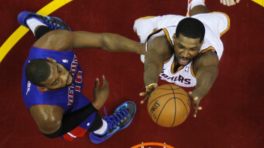 Cleveland Cavaliers' Tristan Thompson, right, shoots inside Detroit Pistons' Greg Monroe (10) in the first half of an NBA basketball game on Wednesday, April 10, 2013, in Cleveland. (AP Photo/Mark Duncan)