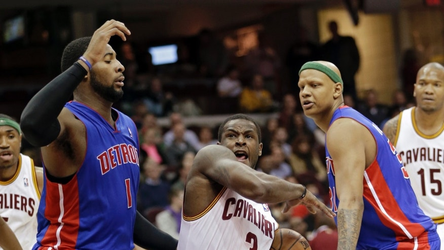 Cleveland Cavaliers' Dion Waiters (3) drives between Detroit Pistons' Andre Drummond (1) and Charlie Villanueva in the second quarer of an NBA basketball game on Wednesday, April 10, 2013, in Cleveland. (AP Photo/Mark Duncan)
