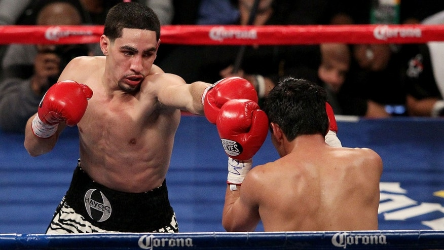 NEW YORK, NY - OCTOBER 20:  Danny Garcia (L) and Erik Morales exchange punches during their WBA Super, WBC & Ring Magazine Super Lightweight title fight at the Barclays Center on October 20, 2012 in the Brooklyn borough of New York City.  (Photo by Alex Trautwig/Getty Images)