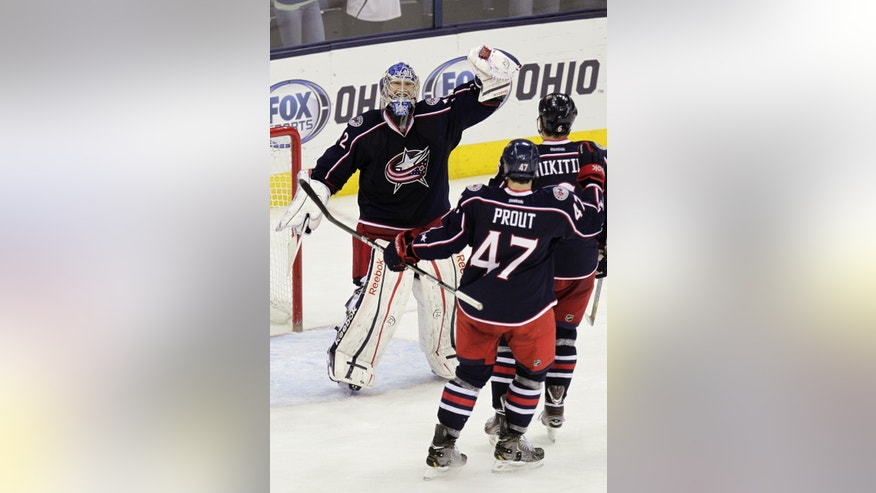Columbus Blue Jackets' Sergei Bobrovsky, left, of Russia, celebrates his shutout against the San Jose Sharks with Dalton Prout (47) and Nikita Nikitin, of Russia, after an NHL hockey game, Tuesday, April 9, 2013, in Columbus, Ohio. The Blue Jackets won 4-0. (AP Photo/Jay LaPrete)