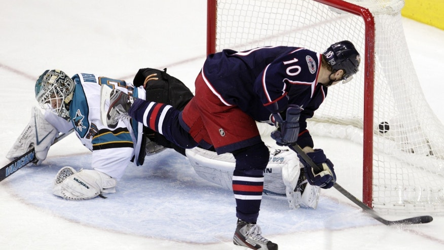 Columbus Blue Jackets' Marian Gaborik, right, of Slovakia, scores against San Jose Sharks goalie Antti Niemi, of Finland, during the third period of an NHL hockey game, Tuesday, April 9, 2013, in Columbus, Ohio. The Blue Jackets won 4-0. (AP Photo/Jay LaPrete)