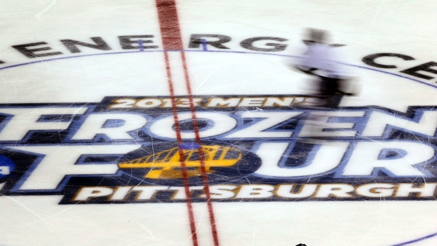 A St. Cloud State player skates over a logo at center ice during an NCAA college hockey practice at the Consol Energy Center, Wednesday, April 10, 2013, in Pittsburgh. St. Cloud State is scheduled to play Quinnipiac Thursday in a Frozen Four semifinal. (AP Photo/Keith Srakocic)