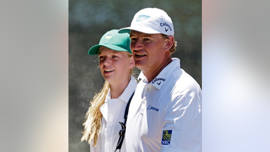 Ernie Els , of South Africa, walks with his daughter Samantha during the par three competition before the Masters golf tournament Wednesday, April 10, 2013, in Augusta, Ga. (AP Photo/Charlie Riedel)