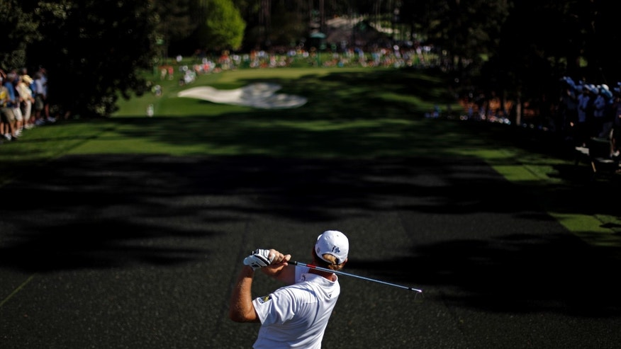 Ernie Els , of South Africa, watches his tee shot on the sixth hole during a practice round for the Masters golf tournament Wednesday, April 10, 2013, in Augusta, Ga. (AP Photo/David Goldman)