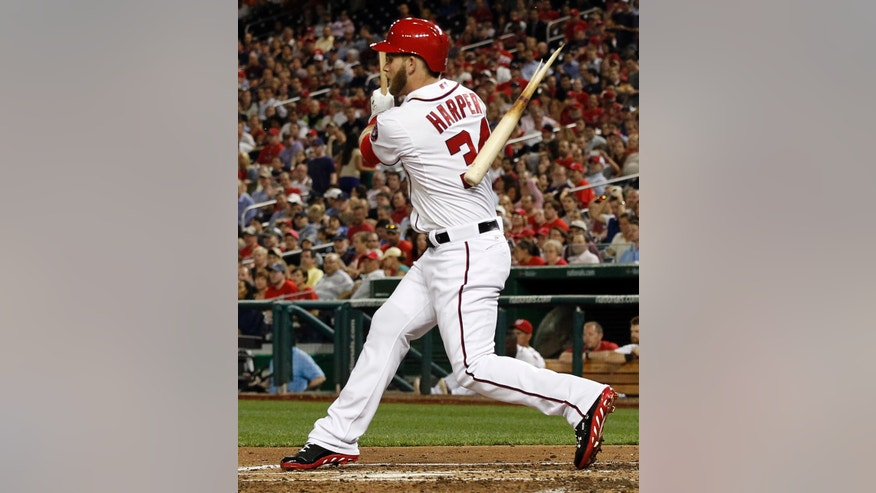 Washington Nationals' Bryce Harper (34) breaks his bat on his single during the fifth inning of an interleague baseball game against the Chicago White Sox at Nationals Park, Wednesday, April 10, 2013, in Washington. (AP Photo/Alex Brandon)
