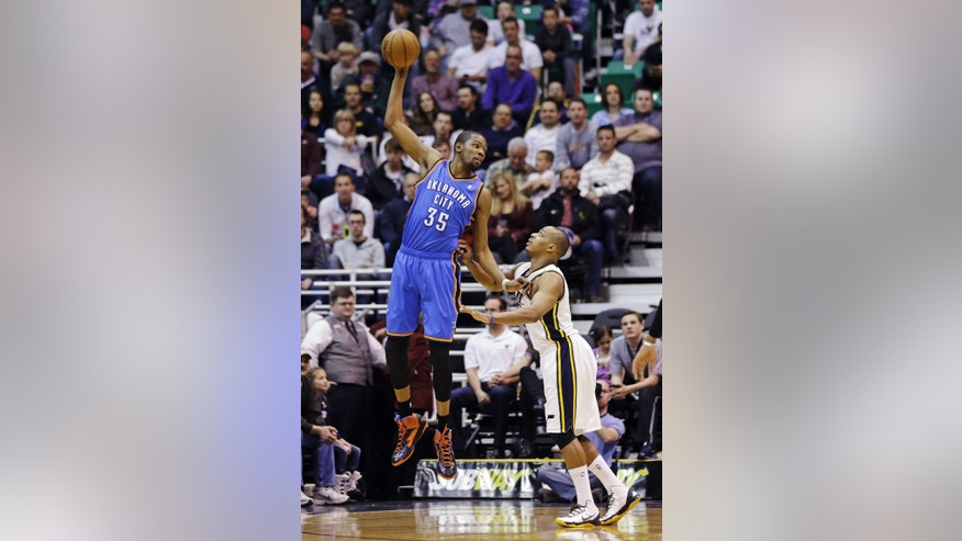 Oklahoma City Thunder's Kevin Durant (35) receives a pass as Utah Jazz's Randy Foye (8) defends in the fourth quarter during an NBA basketball game, Tuesday, April 9, 2013, in Salt Lake City. The Thunder won 90-80. (AP Photo/Rick Bowmer)