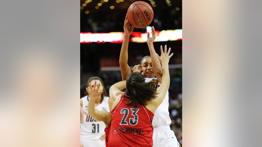 Connecticut guard Bria Hartley (14) battles to pass the ball against Louisville guard Shoni Schimmel (23) during first half of the national championship game of the women's Final Four of the NCAA college basketball tournament, Tuesday, April 9, 2013, in New Orleans. (AP Photo/Dave Martin)
