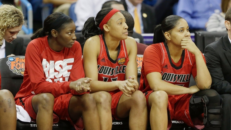 Louisville players on the bench watch during the second half of the national championship game against Connecticut at the women's Final Four of the NCAA college basketball tournament, Tuesday, April 9, 2013, in New Orleans. (AP Photo/Dave Martin)