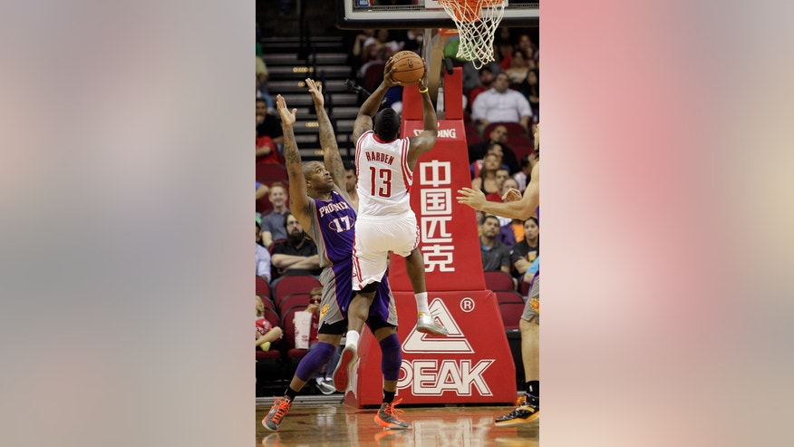 Houston Rockets guard James Harden (13) shoots over Phoenix Suns guard P.J. Tucker (17) during the first half of an NBA basketball game Tuesday, April 9, 2013, in Houston. (AP Photo/Bob Levey)
