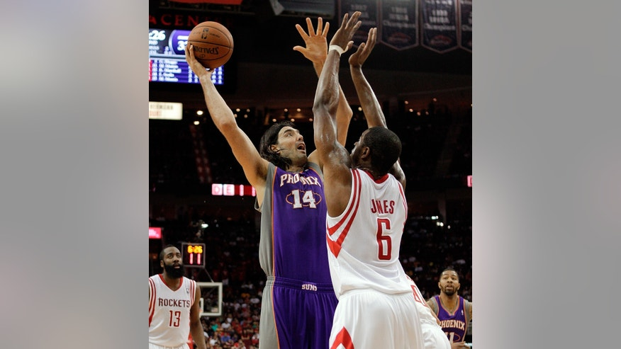 Phoenix Suns forward Luis Scola (14) shoots over Houston Rockets forward Terrence Jones (6) during the first half of an NBA basketball game Tuesday, April 9, 2013, in Houston. (AP Photo/Bob Levey)