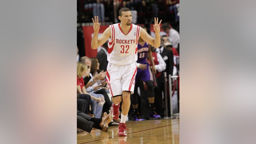 Houston Rockets guard Francisco Garcia (32) signals after completing a 3-point shot against the Phoenix Suns during the first half of an NBA basketball game Tuesday, April 9, 2013, in Houston. (AP Photo/Bob Levey)