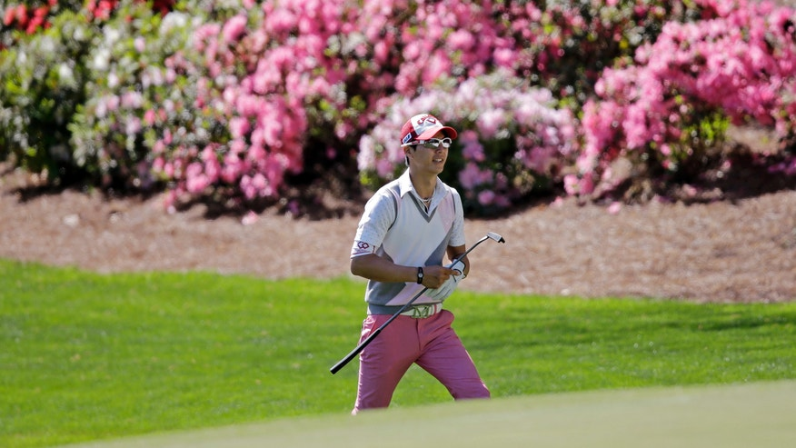 Ryo Ishikawa, of Japan, walks up to the 13th green during a practice round for the Masters golf tournament Wednesday, April 10, 2013, in Augusta, Ga. (AP Photo/Matt Slocum)
