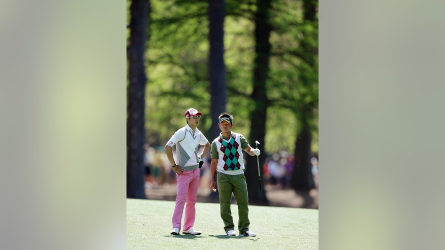Ryo Ishikawa, left, of Japan, talks to Hiroyuki Fujita, of Japan, on the 13th fairway during a practice round for the Masters golf tournament Wednesday, April 10, 2013, in Augusta, Ga. (AP Photo/Matt Slocum)
