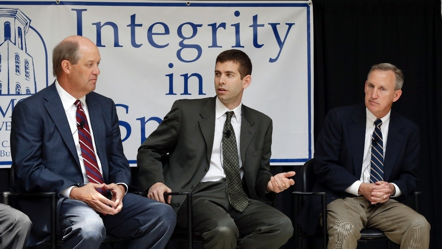 Basketball coaches Kevin Stallings, left, of Vanderbilt; Brad Stevens, center, of Butler; and Rick Byrd, right, of Belmont, take part in a panel on integrity in college basketball on Wednesday, April 10, 2013, in Nashville, Tenn. The coaches discussed maintaining integrity and honor in college sports' changing landscape with the ever-increasing pressure to win. (AP Photo/Mark Humphrey)