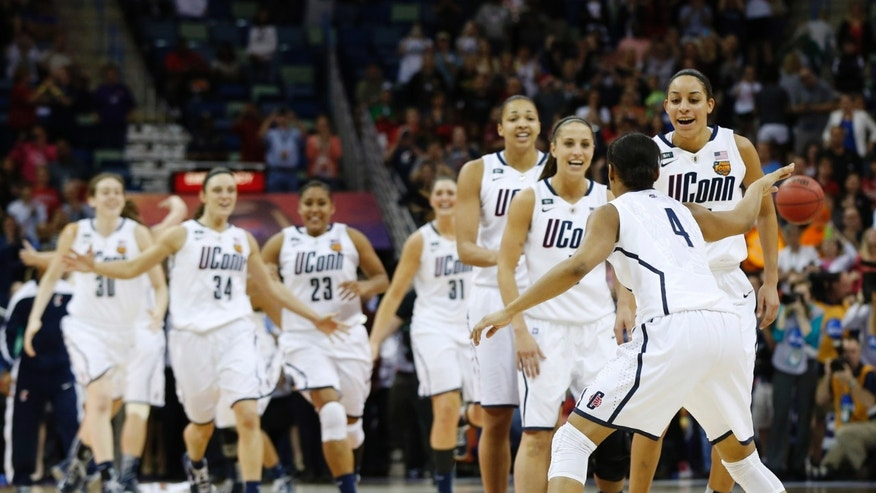 Connecticut players celebrate after defeating Louisville 93-60 in the national championship game of the women's Final Four of the NCAA college basketball tournament, Tuesday, April 9, 2013, in New Orleans. (AP Photo/Dave Martin)