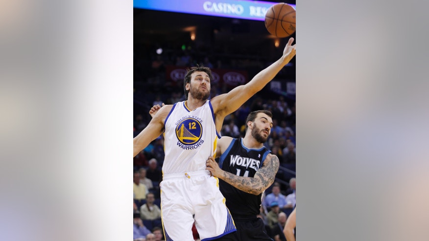 Golden State Warriors' Andrew Bogut reaches for a rebound in front of Minnesota Timberwolves' Jose Barea during the first half of an NBA basketball game, Tuesday, April 9, 2013, in Oakland, Calif. (AP Photo/George Nikitin)