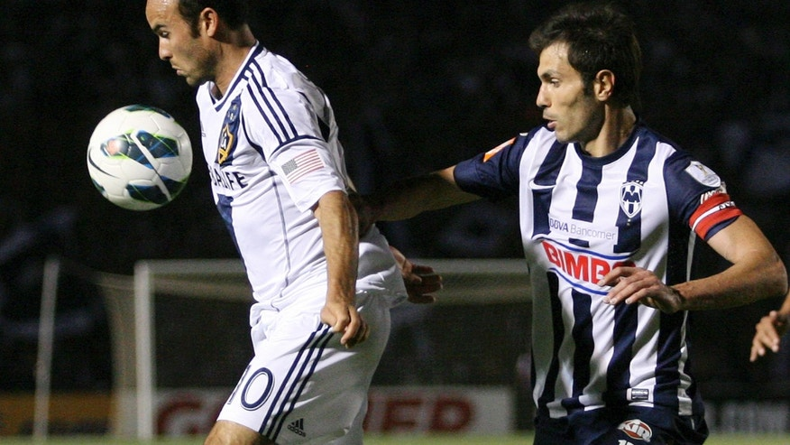 L.A. Galaxy's Landon Donovan, left, controls the ball under pressure from Monterrey's Jose Maria Basanta at a CONCACAF Champions League semi-final soccer match in Monterrey, Mexico, Wednesday, April 10, 2013. (AP Photo/Alfredo Lopez, JAM MEDIA)