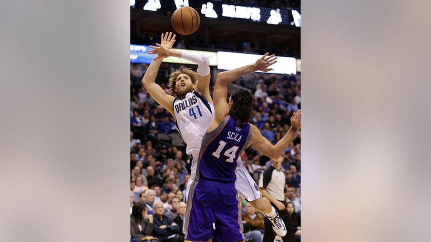 Dallas Mavericks forward Dirk Nowitzki (41), of Germany, is fouled by Phoenix Suns forward Luis Scola (14), of Argentina, during the second half of an NBA basketball game, Wednesday, April 10, 2013, in Dallas. The Suns won 102-91.  (AP Photo/LM Otero)