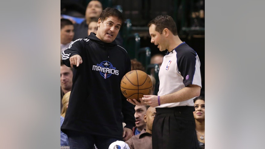 Dallas Mavericks owner Mark Cuban argues a call with referee Brian Forte (45) during the first half of an NBA basketball game against the Phoenix Suns, Wednesday, April 10, 2013, in Dallas. (AP Photo/LM Otero)