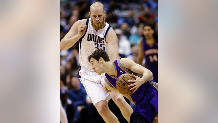 Phoenix Suns guard Goran Dragic (1), of Slovenia, drives against Dallas Mavericks center Chris Kaman (35) during the first half of an NBA basketball game, Wednesday, April 10, 2013, in Dallas. (AP Photo/LM Otero)