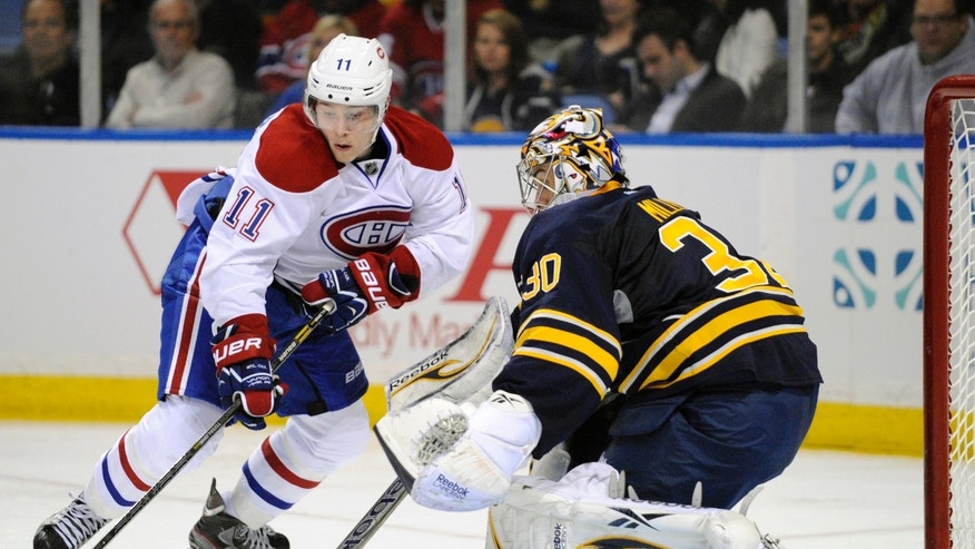 Montreal Canadiens right winger Brendan Gallagher (11) moves around Buffalo Sabres goaltender Ryan Miller (30) for a goal during the second period of an NHL hockey game in Buffalo, N.Y., Thursday, April 11, 2013. (AP Photo/Gary Wiepert)