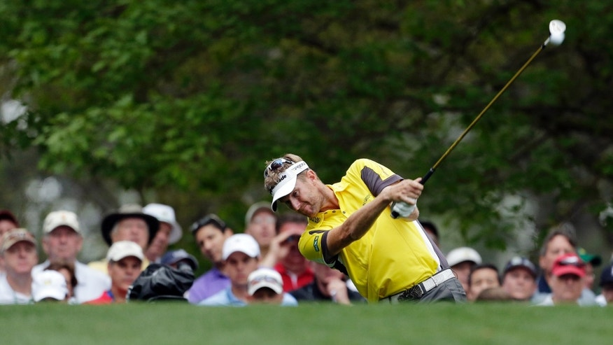 David Lynn, of England, tees off on the fourth hole during the first round of the Masters golf tournament Thursday, April 11, 2013, in Augusta, Ga. (AP Photo/Charlie Riedel)