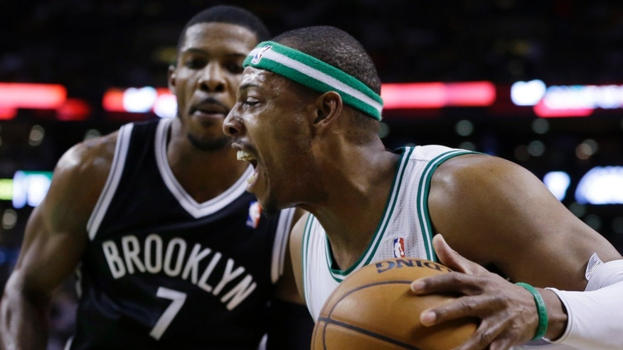 Boston Celtics forward Paul Pierce, right, drives past Brooklyn Nets guard Joe Johnson (7) during the first quarter of an NBA basketball game in Boston, Wednesday, April 10, 2013. (AP Photo/Elise Amendola)