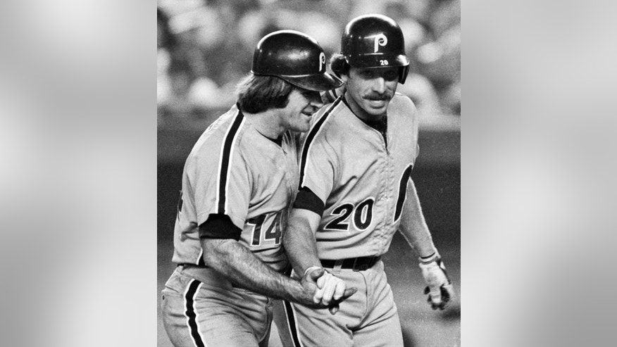 ADVANCE FOR WEEKEND EDITIONS, APRIL 13-14 - FILE - In this Aug. 15, 1981, file photo, Philadelphia Phillies' Mike Schmidt, right, is congratulated by teammate Pete Rose after hitting a two-run home run against the New York Mets in the third inning of a baseball game a New York's Shea Stadium. According to Schmidt, it's unbelievable that in 1979 Pete joined the Phillies. The player I wanted so much to be like as a kid was now my teammate, friend and mentor. (AP Photo/Ray Stubblebine, File)