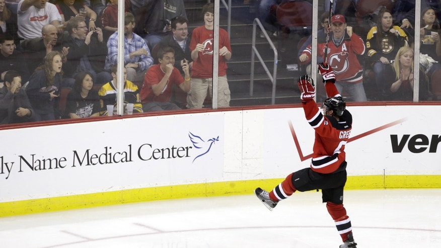 New Jersey Devils' Andy Greene celebrates after scoring a goal against the Boston Bruins during the third period of an NHL hockey game, Wednesday, April 10, 2013, in Newark, N.J. (AP Photo/Julio Cortez)