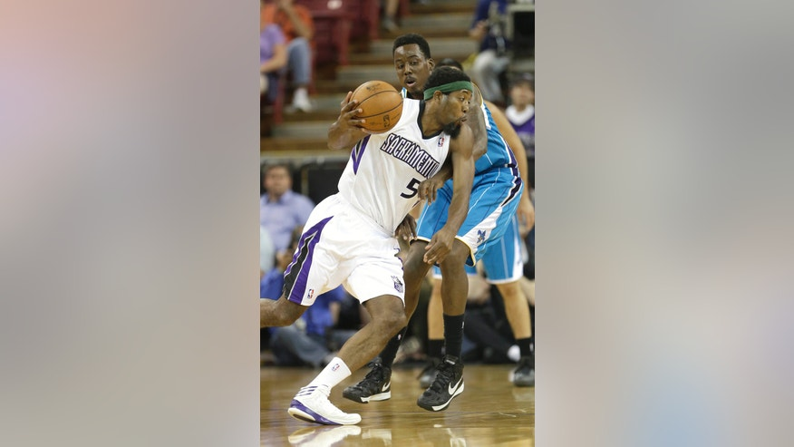 Sacramento Kings forward John Salmons, foreground, drives against New Orleans Hornets foward Al-Farouq Aminu during the first quarter of an NBA basketball game in Sacramento, Calif., Wednesday, April 10, 2013. (AP Photo/Rich Pedroncelli)