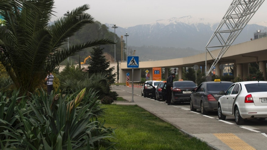 In this Friday, April 5, 2013 photo snow-covered peaks of Krasnaya Polyana are seen from the airport of the city of Sochi which is hosting the 2014 Winter Olympics. The Roza Khutor ski resort is set to collect about half a million cu. meters of snow ahead of the games as a contingency plan in the event of a lack of snow.(AP Photo/ Nataliya Vasilyeva)