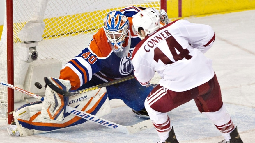 Phoenix Coyotes' Chris Conner has his shot turned away by Edmonton Oilers goalie Devan Dubnyk during the second period of an NHL hockey game Wednesday, April 10, 2013, in Edmonton, Alberta. (AP Photo/The Canadian Press, Jason Franson)
