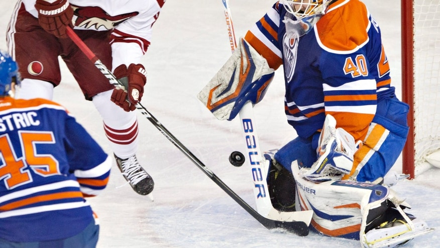 Phoenix Coyotes' Mikkel Boedker, left, is stopped by Edmonton Oilers goalie Devan Dubnyk during the first period of an NHL hockey game Wednesday, April 10, 2013, in Edmonton, Alberta. (AP Photo/The Canadian Press, Jason Franson)