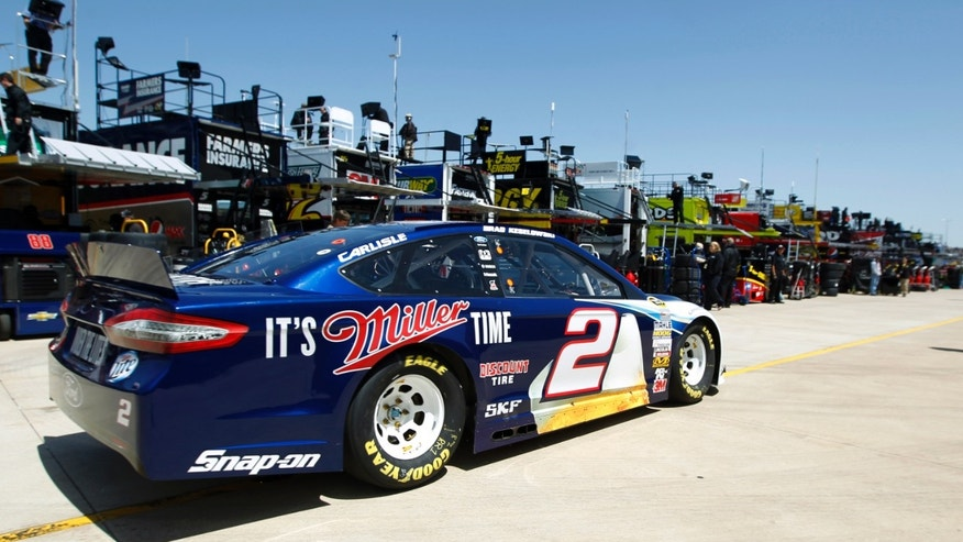 Brad Keselowski returns to the garage after testing at Texas Motor Speedway, Thursday, April 11, 2013, in Fort Worth,Texas. The NASCAR Sprint Cup Series NRA 500 auto race is scheduled to run Saturday, April 13. (AP Photo/The Fort Worth Star-Telegram, Ron Jenkins)  MAGS OUT; (FORT WORTH WEEKLY, 360 WEST); INTERNET OUT