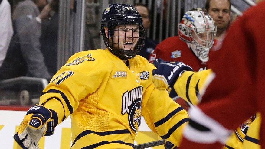 Quinnipiac forward Jeremy Langlois (17) celebrates his first-period goal against St. Cloud State during their NCAA college hockey Frozen Four semifinal tournament game in Pittsburgh, Thursday, April 11, 2013. (AP Photo/Gene J. Puskar)