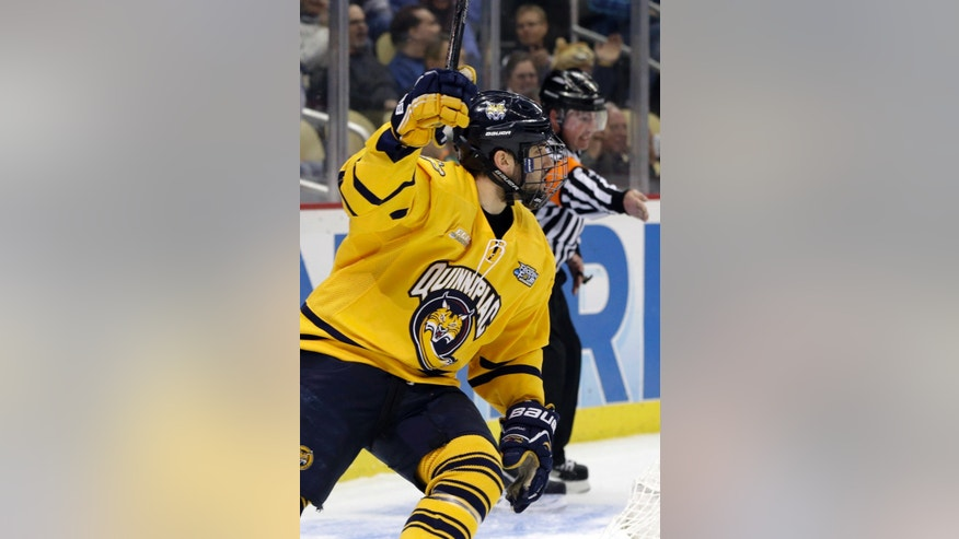 Quinnipiac forward Ben Arnt celebrates his first-period goal against St. Cloud State during an NCAA college hockey Frozen Four semifinal tournament game in Pittsburgh, Thursday, April 11, 2013. (AP Photo/Gene J. Puskar)