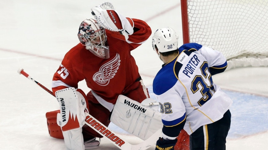 Detroit Red Wings goalie Jimmy Howard (35) stops a shot by St. Louis Blues center Chris Porter (32) in the third period of an NHL hockey game in Detroit Sunday April 7, 2013. St. Louis won 1-0. (AP Photo/Paul Sancya)