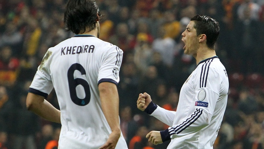 Real Madrid's Ronaldo, right, celebrates after scoring his second goal against Galata Saray during a Champions League quarterfinal soccer match at Ali Sami Yen Spor Kompleksi in Istanbul, Turkey, Tuesday, April 9, 2013. (AP Photo/Thanassis Stavrakis)