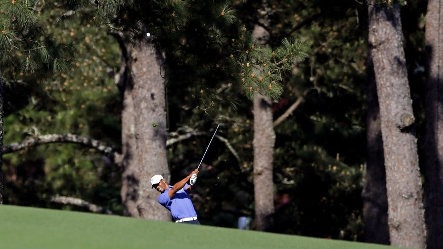 Tiger Woods hits on the 17th fairway during a practice round for the Masters golf tournament Wednesday, April 10, 2013, in Augusta, Ga. (AP Photo/Darron Cummings)