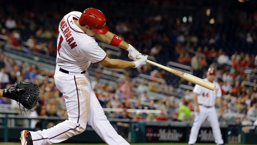 Washington Nationals' Ryan Zimmerman hits a two-RBI double during the fourth inning of an interleague baseball game against the Chicago White Sox at Nationals Park, Thursday, April 11, 2013, in Washington. (AP Photo/Alex Brandon)