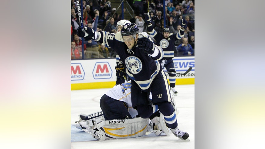 Columbus Blue Jackets' Artem Anisimov, of Russia, celebrates his goal against the St. Louis Blues during the second period of an NHL hockey game, Friday, April 12, 2013, in Columbus, Ohio. (AP Photo/Jay LaPrete)