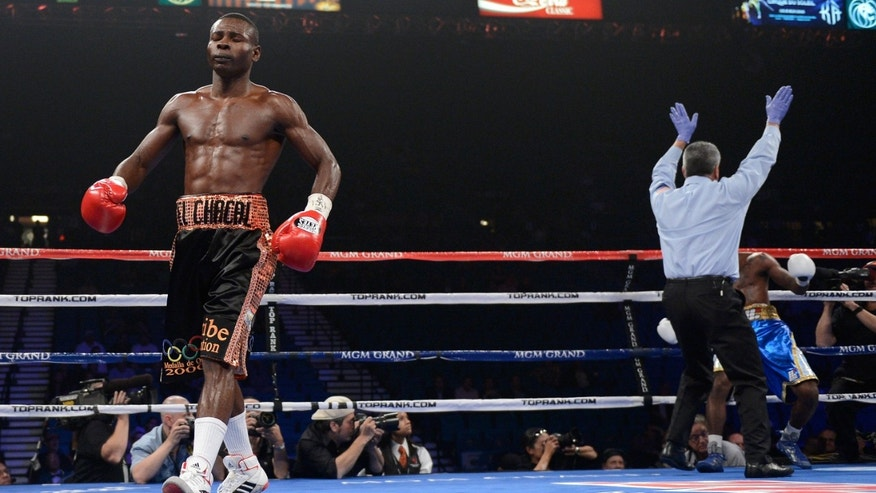 LAS VEGAS, NV - JUNE 09:  Guillermo Rigondeaux (L) reacts after knocking out Teon Kennedy during their WBA super bantamweight title fight at MGM Grand Garden Arena on June 9, 2012 in Las Vegas, Nevada.  (Photo by Kevork Djansezian/Getty Images)