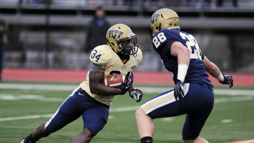 Pittsburgh running back Issac Bennette picks up first-down yardage against linebacker Anthony Gonzalez, right, during the Pittsburgh  spring football game Friday, April 12, 2013,in Bethel Park, Pa. (AP Photo/John Heller)